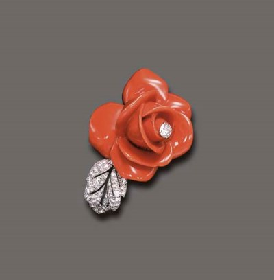 **A CORAL AND DIAMOND BROOCH,