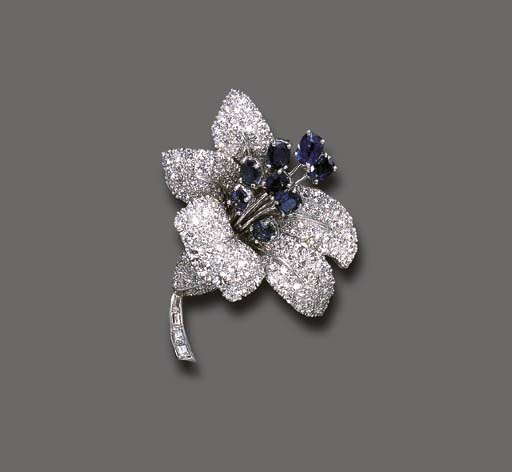 A DIAMOND AND SAPPHIRE BROOCH,