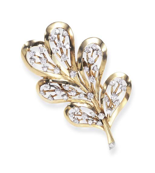 A DIAMOND AND GOLD BROOCH, BY
