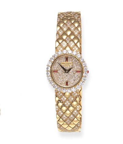 A DIAMOND AND RUBY WRISTWATCH,
