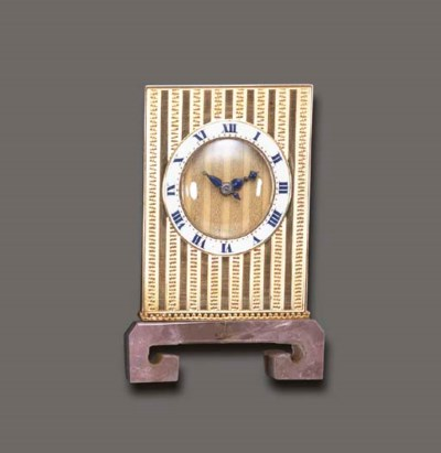 AN ART DECO GOLD, ENAMEL AND R