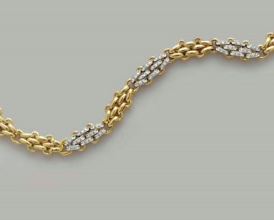 AN 18K GOLD AND DIAMOND NECKLA