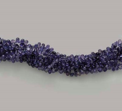 A MULTI STRAND IOLITE BEAD AND