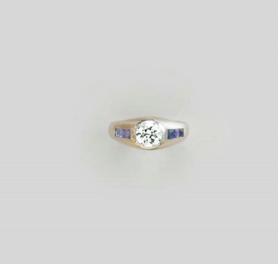 A DIAMOND, SAPPHIRE AND 18K WH