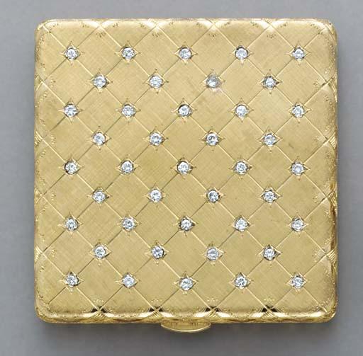 AN 18K GOLD AND DIAMOND COMPAC