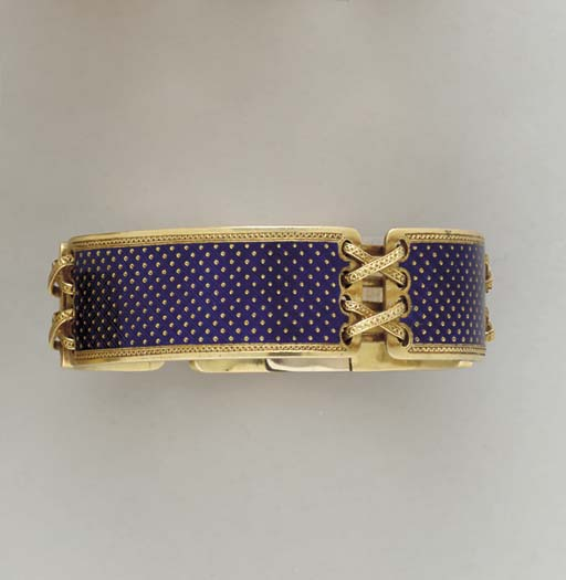 AN ANTIQUE 18K GOLD AND ENAMEL