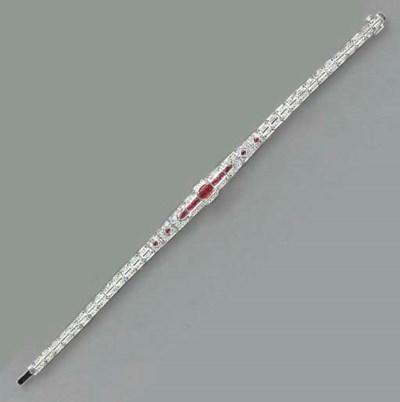 A RUBY, DIAMOND AND 18K WHITE