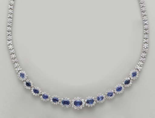 A SAPPHIRE, DIAMOND AND 18K WH