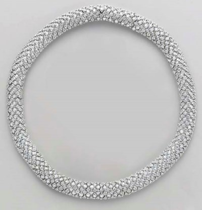 A DIAMOND AND 18K WHITE GOLD N