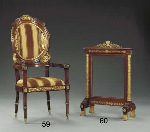 A Louis XVI style parcel-gilt