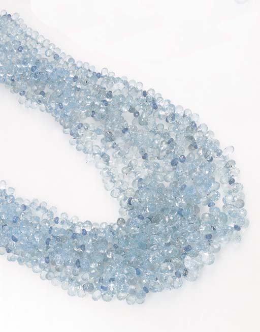 A SEVEN-STRAND AQUAMARINE AND