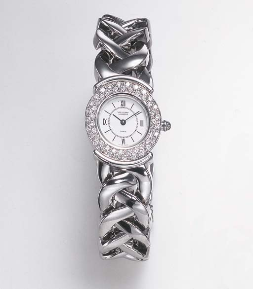 A DIAMOND AND STEEL WRISTWATCH