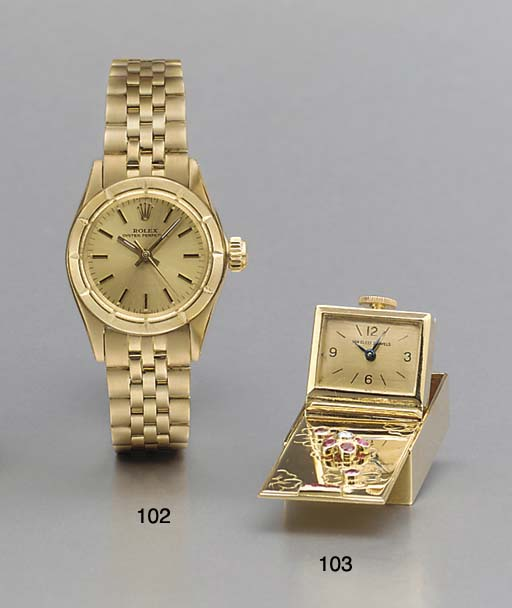 Rolex. A lady's 18K gold self-winding water-resistant wristwatch with bracelet