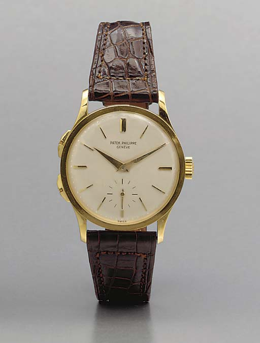 Patek Philippe. A fine and rare 18K gold dual time zone wristwatch