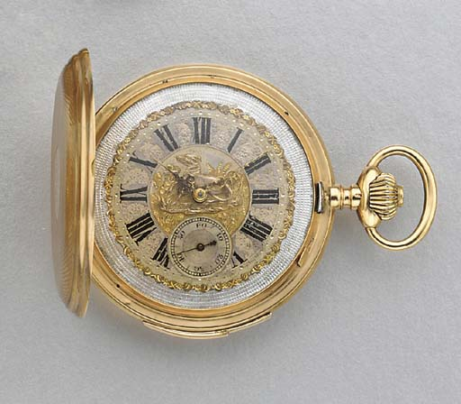 Swiss. A 14K gold hunter case minute repeating keyless lever watch