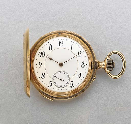 Swiss. A 14K gold hunter case two train minute repeating grande sonnerie keyless lever watch