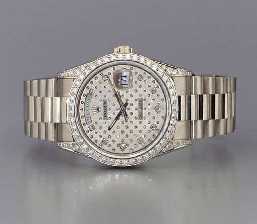 Rolex. A fine 18K white gold and diamond-set self-winding waterproof wristwatch with sweep center seconds, day, date and bracelet