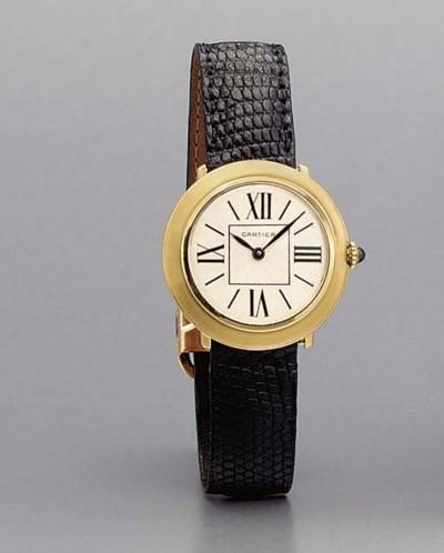 Cartier. A fine 18K gold wrist