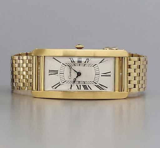 Cartier. A large and rare 18K gold curved rectangular wristwatch