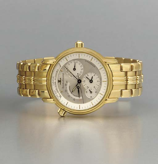 Jaeger-LeCoultre. An 18K gold World Time calendar dual time zone wristwatch with power reserve and bracelet