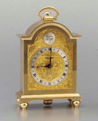 Swiss. A gilt brass minute rep