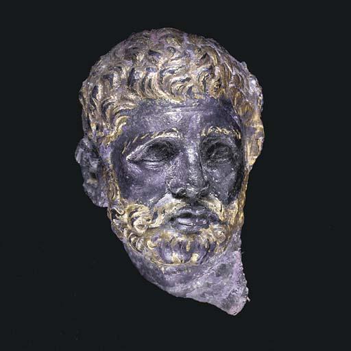 A GREEK GILT SILVER HEAD OF A