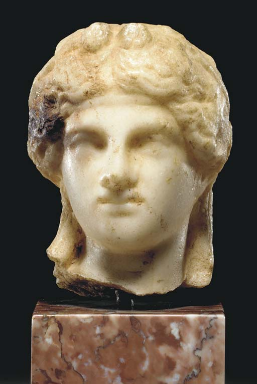A GREEK MARBLE HEAD OF DIONYSO