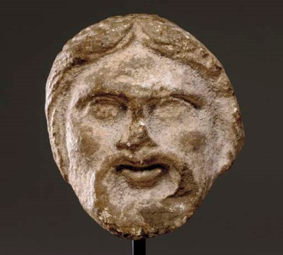 A ROMAN LIMESTONE THEATER MASK