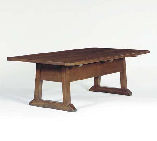 AN OAK CLIP CORNER DINING TABL