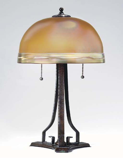 A HAMMERED COPPER AND AURENE GLASS TABLE LAMP
