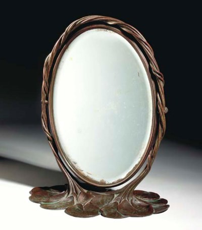 A 'POND LILY' BRONZE MIRROR