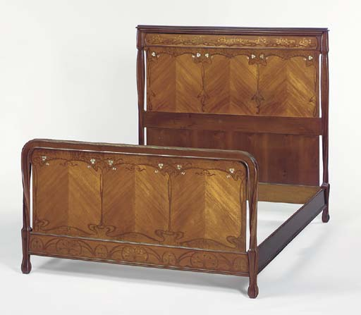 'AUX PAVOTS', A CARVED AND INLAID MAHOGANY BEDSTEAD