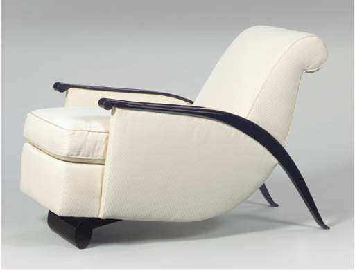 'GONSE', A CHESTNUT BROWN LACQUERED ARMCHAIR