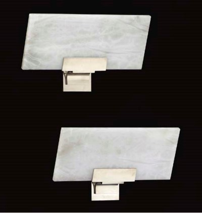 A PAIR OF SILVERED BRONZE WALL