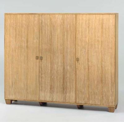A LIMED-OAK THREE DOOR CABINET