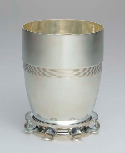 A SILVER AND GLASS VASE