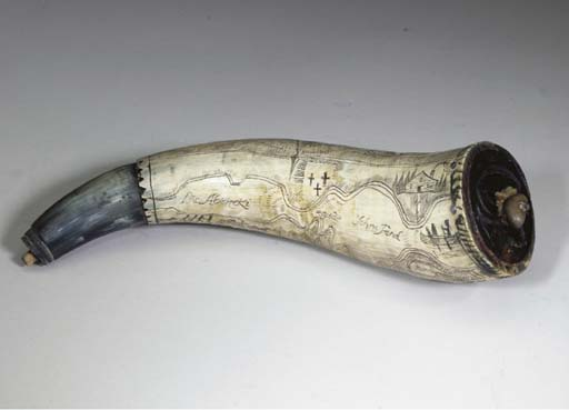 AN ENGRAVED POWDERHORN