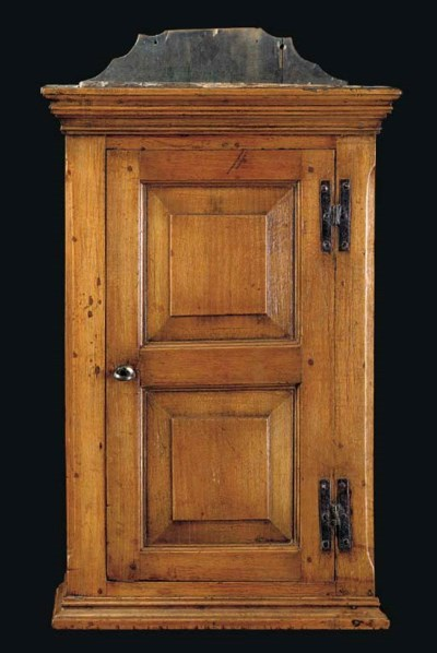A CHIPPENDALE WALNUT HANGING C