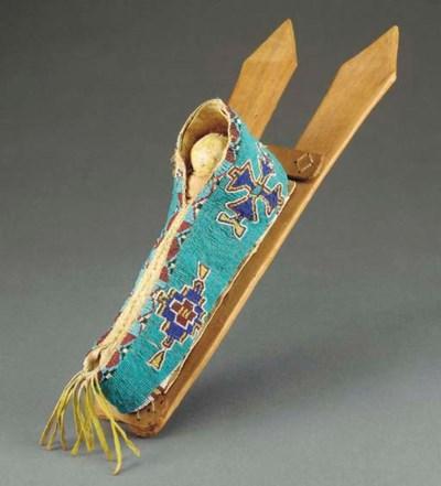 A KIOWA BEADED HIDE MODEL CRAD