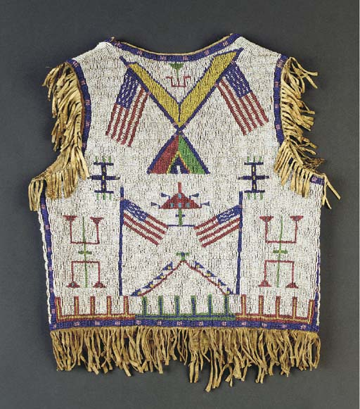 A SIOUX BOY'S BEADED AND FRING