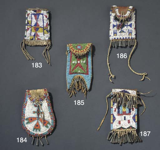 A SIOUX BEADED HIDE POUCH