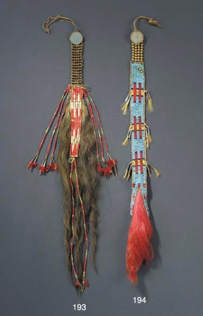 A SIOUX QUILLED HIDE HAIR ORNA