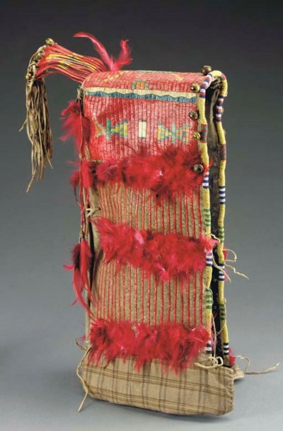 A SIOUX QUILLED HIDE BABY CARR