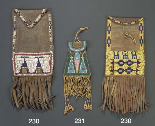 TWO ARAPAHO BEADED LEATHER DIS