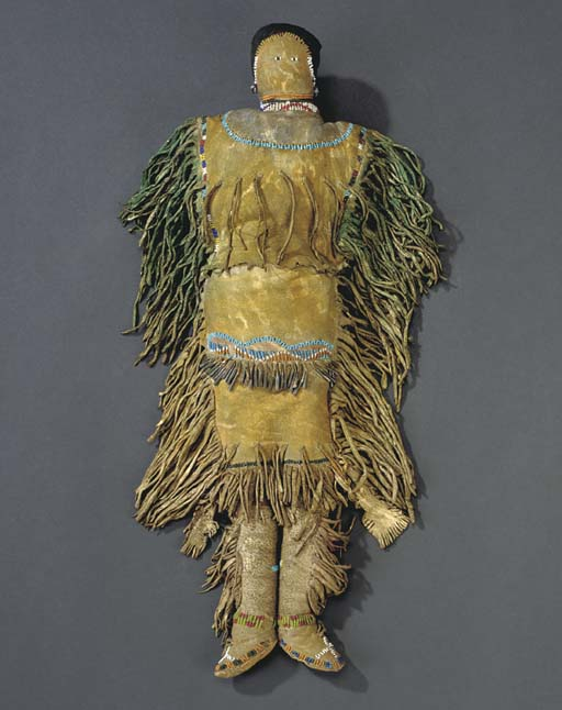 AN APACHE BEADED AND FRINGED H