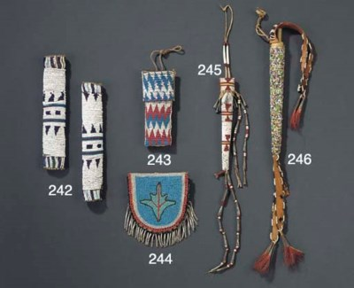 A SIOUX BEADED HIDE AWL CASE