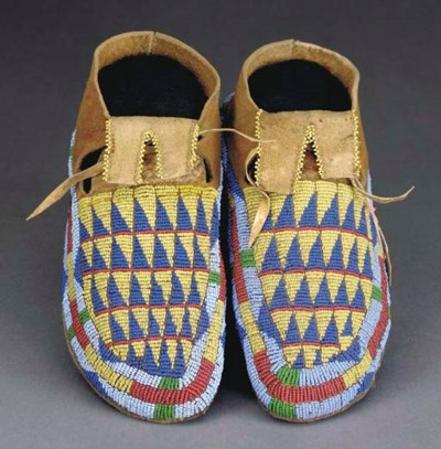 A PAIR OF CROW BEADED HIDE MOC