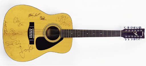ROCK STARS SIGNED GUITAR AND A