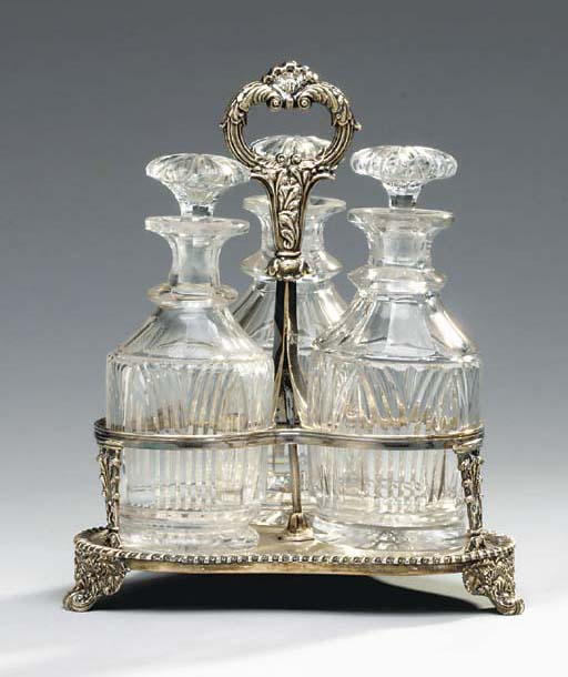 A GEORGE III STYLE SILVER-PLATED DECANTER STAND,