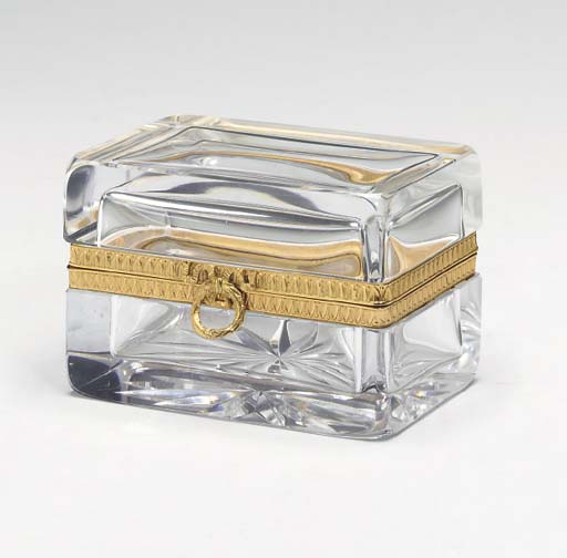 AN EMPIRE STYLE GILT METAL MOUNTED GLASS BOX,
